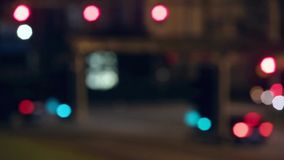 Very blurred semaphore lights and traffic in motion. stock footage