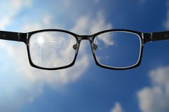 Very blurry sky and glasses with blue sky Royalty Free Stock Photo