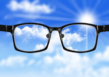 Very blurry sky and glasses with blue sky Stock Images