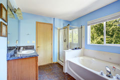 Very bright bathroom in light blue color Stock Image