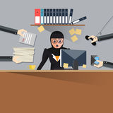 Very busy business woman working her desk in office with a lot of paper work, talking on smart phone. Business concept on Stock Images