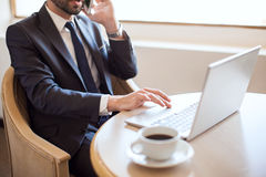 Very busy businessman at work Royalty Free Stock Photos