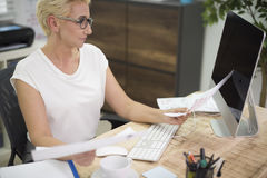 Working woman in the office Stock Photography