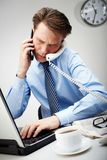 Very busy man Royalty Free Stock Image