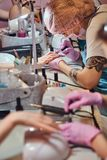 Busy manicure studio with a lot of working staff and clients. Very busy manicure studio with a lot of working staff and clients royalty free stock photography