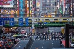 A very busy Tokyo street scene. This show a typical scene in busy Shinjuku. This street leads Kabukicho, Japan's largest and wildest red light district Royalty Free Stock Photo