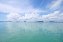 Very Calm Ocean. Nice warm calm ocean with mountain and clouds Stock Photo