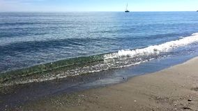 Very calm sea shore on sunny day. Panning to the left and right on very calm sea shore in a sunny day stock video
