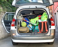 Very car with the trunk full of luggage. Ready for the departure of family holidays Royalty Free Stock Photos