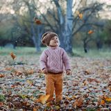 Very cheerful child having fun while tossing up Stock Images