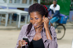 Very cheerful young woman on the phone. Stock Image