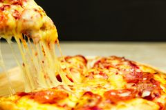 Slice of hot pizza large cheese . stock images