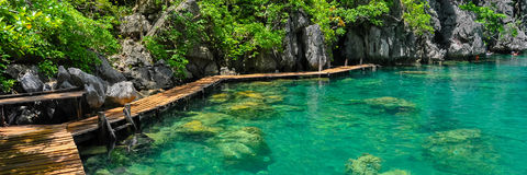 Very Clean and Clear lagoon lake Water next to a Stock Photography