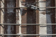 Very close front facing view of metal straps around an old concrete silo royalty free stock image