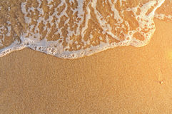 Very close sand beach and wave in Greece, burning sun. Close Stock Image