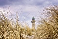 Free Very Close To The Dune Grass With Lighthouse In The Background. Warnemünde, Germany Royalty Free Stock Images - 161423809