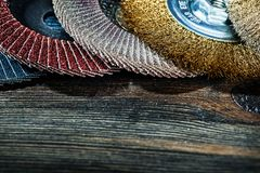 Very close up view abrasive tools discs on vintage wood stock photography