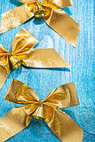 Very close up view on composition of golden bows with bells on o Royalty Free Stock Image