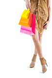 Very close up view on female with colored paperbags in hand isol Stock Images
