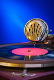 Very close up view on gramophone on blue background royalty free stock photo