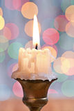 Very close up view on old candle on background of bokeh Stock Image