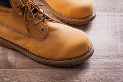 Very close up view on pair of working boots wood Royalty Free Stock Photos