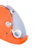 Very close up view on pipe cutter with plastical pipe isolated Stock Image