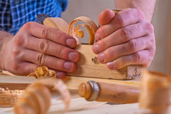 Very close up view on work of joiner plane in hand Stock Photo
