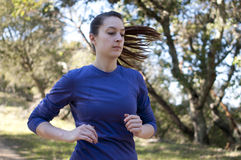 Very close up of woman jogging, facing right, empty space right Royalty Free Stock Image