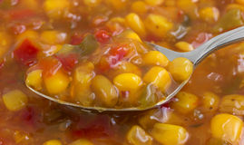 Very close view of corn relish on a spoon Royalty Free Stock Image