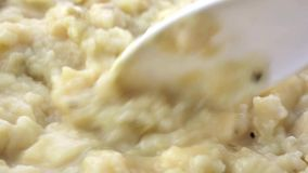 Very close view of potato and leek soup being stirred stock footage