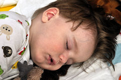 Very closeup portrait of the hairy sleeping baby Stock Photo