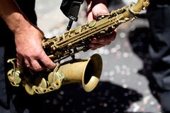 Very closeup portrait of a saxophone player. Royalty Free Stock Image
