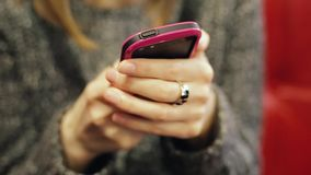 Very closeup shot of female hands typing text message to her parents. Very closeup shot of female hands typing text message on smartphone to her parents stock footage
