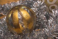 Very closeup view of the silver-golden Christmas decorative glass sphere. With stripes and stars Royalty Free Stock Photography