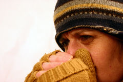 Very Cold. Woman with hat and scarf royalty free stock photography