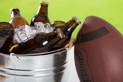 Very cold beers. American football with a cold beer in a bucket Stock Images