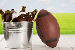 Very cold beers. American football with a cold beer in a bucket Stock Photography