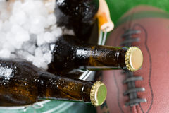 Very cold beers. American football with a cold beer in a bucket Royalty Free Stock Image