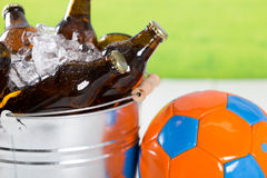 Very cold beers. Football with a beer in a cold bucket Stock Photo