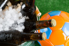 Very cold beers. Football with a beer in a cold bucket Royalty Free Stock Image