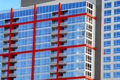 Very colorful high rise building in Chicago. High rise building in Chicago with blue glass and red exterior beams stock images