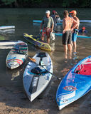 Very colorful paddle boards and 3 racers stock images