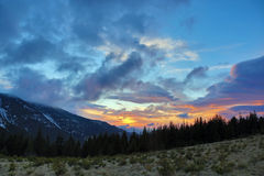 Very colorful sunset in the mountains Stock Images