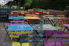 Very colorful tables and chairs. Paris, France Royalty Free Stock Photography