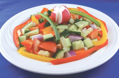 Very colourful salad. Slices and cubes of vegetables in a colourful salad stock image