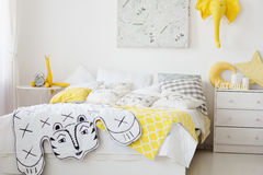 Very cosy bedroom with a large bed full. Of cushions and blankets stock images