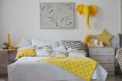 Very cosy bedroom with a large bed. Full of cushions and blankets Stock Image