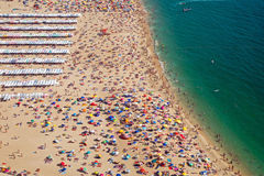 Very crowded beach in Portugal. A very crowded beach in Nazare, Portugal royalty free stock photography