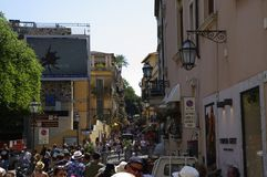 Very crowded street of famous Taormina town in August peak season of 2017er, Sicily, Italy. TAORMINA, ITALY - August 18, 2017: Very crowded street of famous royalty free stock photos
